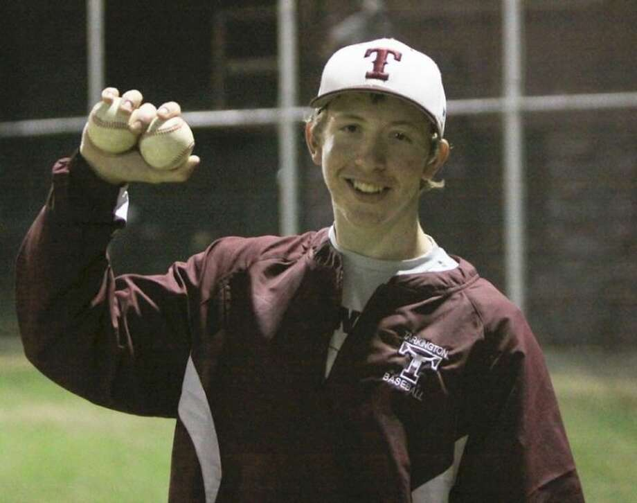 Tarkington's Chance Evans holds up two baseballs after his no-hitter against Shepherd, symbolizing the two no-hitters he has thrown this season. Evans is the number two athlete of District 22-3A West.