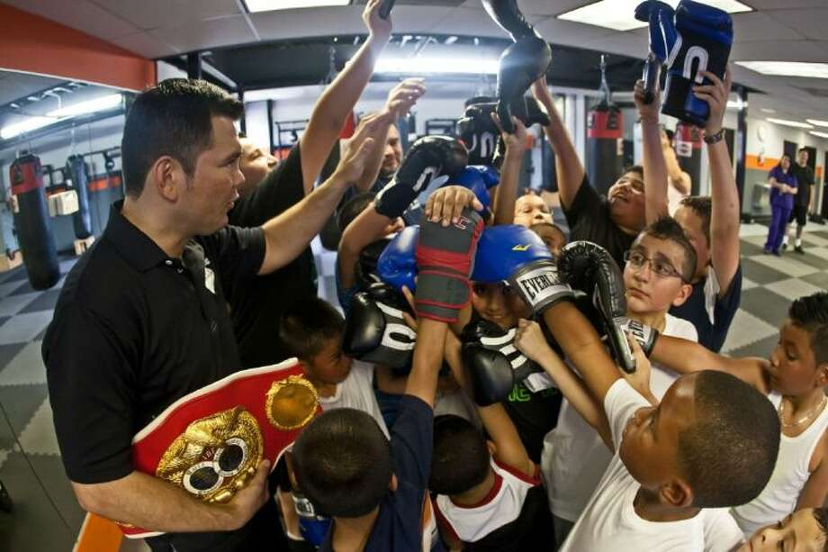 Raul Marquez and his children's class finish the day in a huddle on April 29, 2013.
