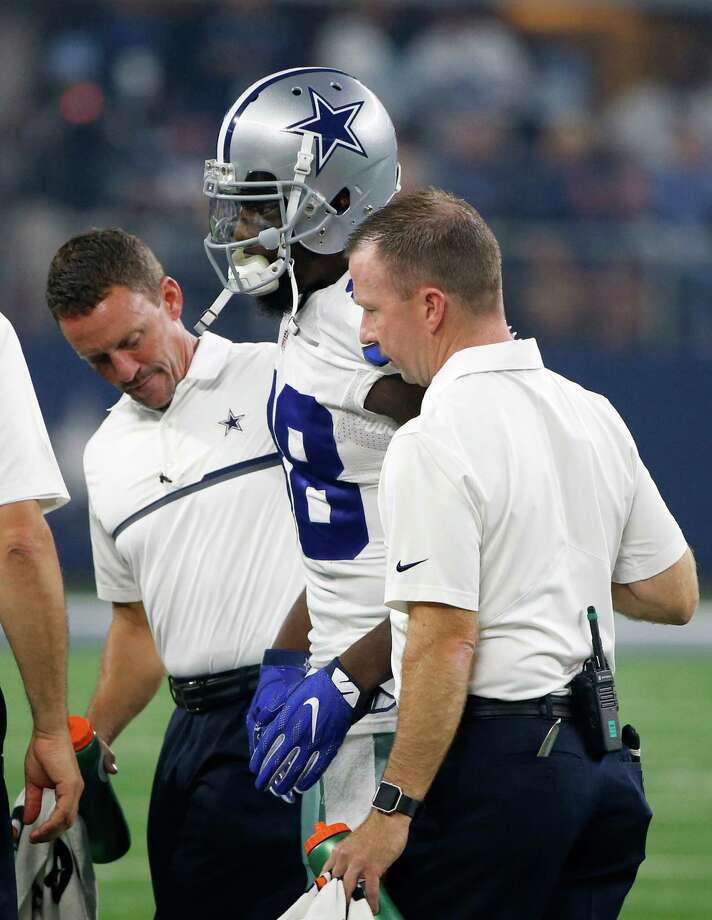 Dez Bryant was helped off the field after suffering an injury in the first half of Dallas' victory over Chicago on Sunday. He could miss up to three weeks, but no determination has been made. Photo: Ron Jenkins / Associated Press / FR171331 AP