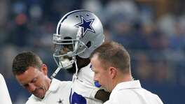 Dez Bryant was helped off the field after suffering an injury in the first half of Dallas' victory over Chicago on Sunday. He could miss up to three weeks, but no determination has been made.