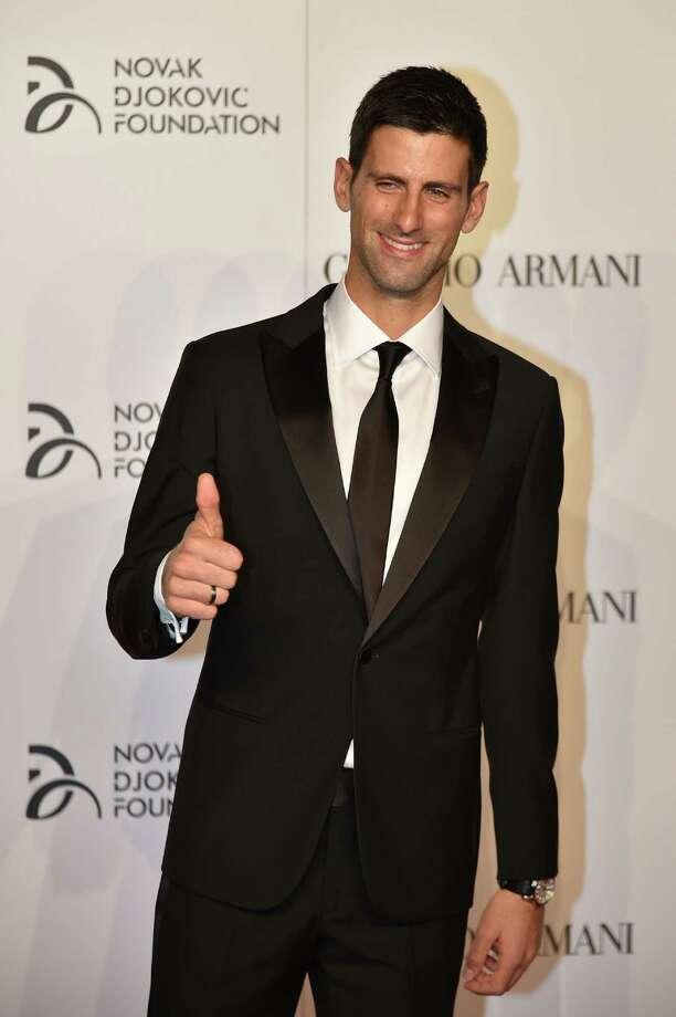 Tennis player Novak Djokovic arrives at the Charity Gala Dinner for the Novak Djokovic Foundation on September 20, 2016 in Milan. / AFP PHOTO / ALBERTO PIZZOLIALBERTO PIZZOLI/AFP/Getty Images Photo: ALBERTO PIZZOLI / AFP or licensors