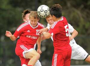 New Canaan Wesley Farley and Stephen Curialein batlle for the ball with Westhill Casey Ottaviano and Dylan Sparks in the second half of a boys soccer match at Westhill High School on Wednesday, Sept. 28, 2016 in Stamford, Connecticut. New Canaan defeated Westhill 1-0.