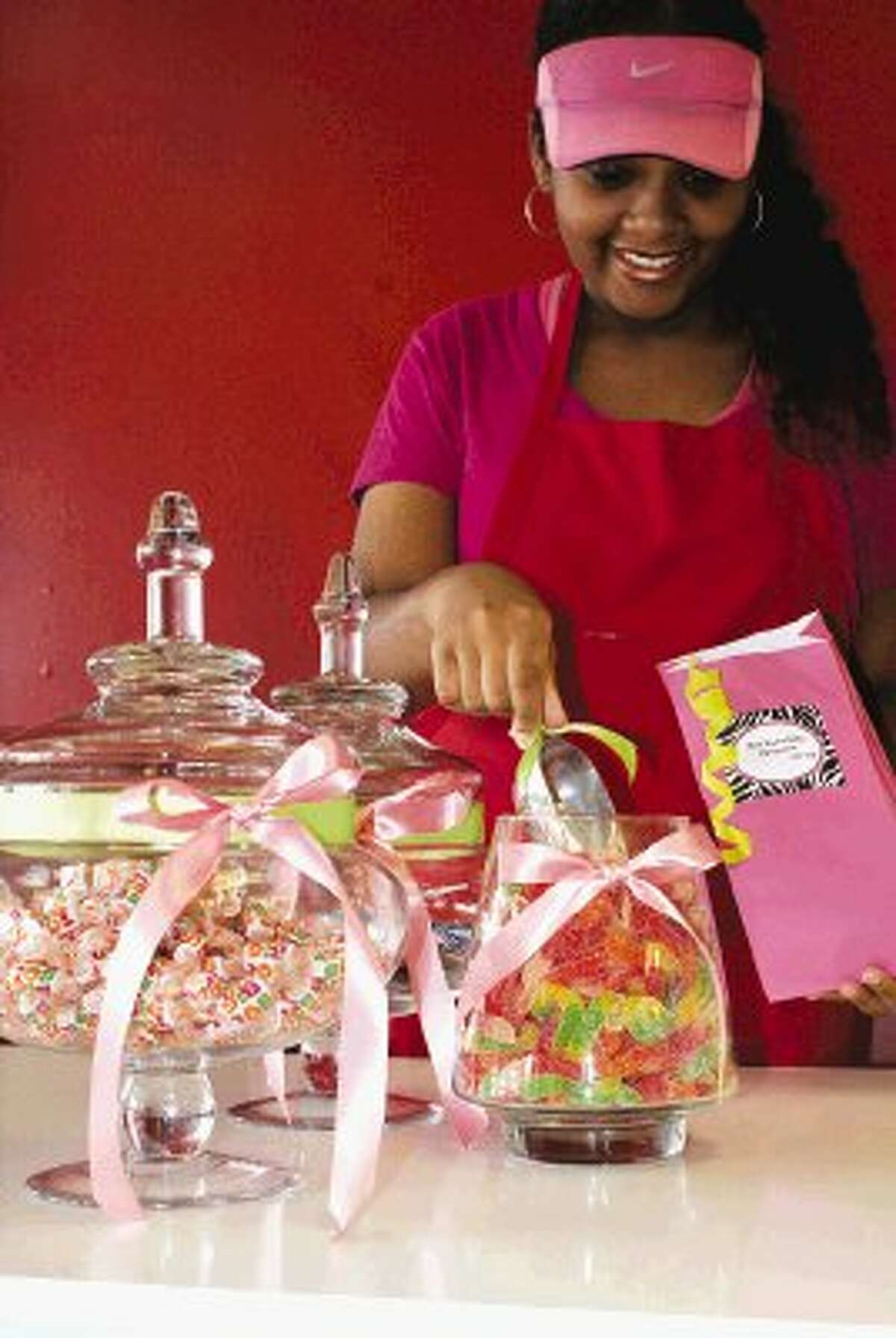 Summer Bowie helps serve customers at her families retro candy store, I.Candy Sweets.