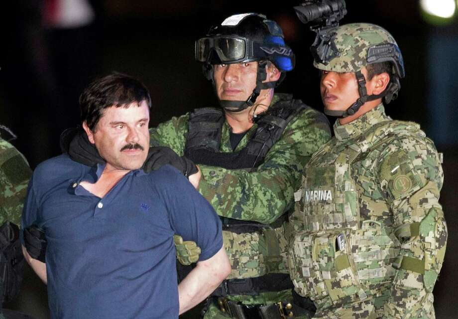 "FILE - In this Jan. 8, 2016 file photo, Joaquin ""El Chapo"" Guzman is made to face the press as he is escorted to a helicopter in handcuffs by Mexican soldiers and marines at a federal hangar in Mexico City, Mexico, following his recapture six months after escaping from a maximum security prison. (AP Photo/Eduardo Verdugo, File) Photo: Eduardo Verdugo / AP"