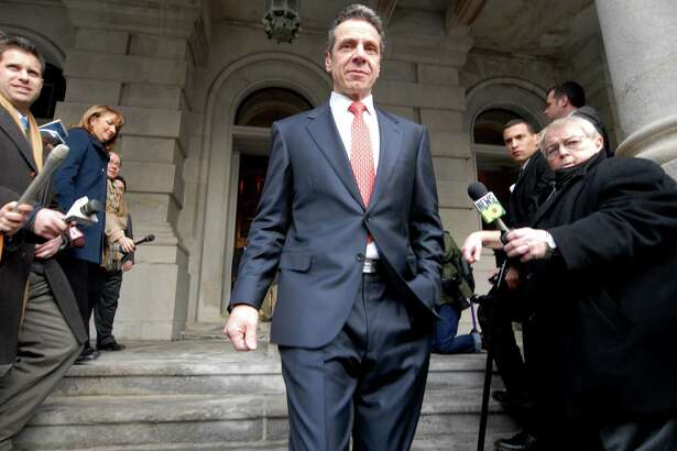 Gov. Andrew Cuomo steps out of the Capitol onto State Street where he touted the removal of Jersey Barriers from outside the Capitol building on Saturday following his inauguration on Jan. 1, 2011, in Albany, N.Y. (Will Waldron / Times Union archive)