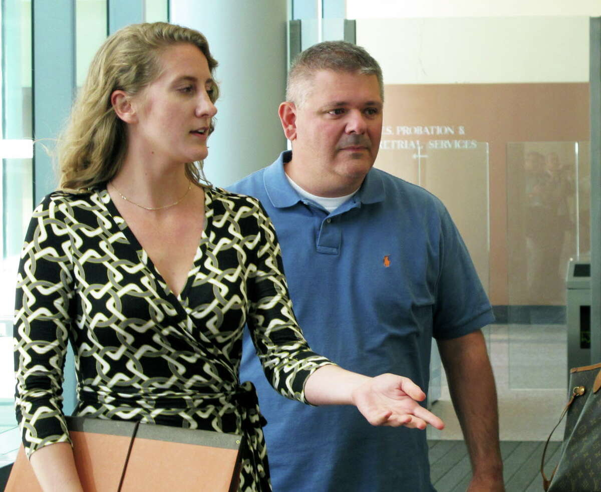 Kevin Schuler, right, leaves U.S. District Court in Buffalo, N.Y., Thursday, Sept. 22, 2016, after posting bond following an appearance in a corruption probe. The LPCiminelli vice president was among eight people charged in a bribery and fraud case connected to Gov. Andrew Cuomo's efforts to revitalize the upstate New York economy. (AP Photo/Carolyn Thompson) ORG XMIT: NYR104