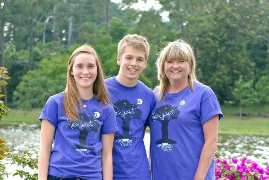 Local high school senior, Austin Tomlinson, center; with Max's mom, Katie Keevill, left was announced as the winner of the first Maximilian Keevill Memorial Scholarship recipient May 20. Keevill was killed in an automobile accident Jan. 15, 2011 on his way to boy scout camp so friends and family set up a scholarship in his honor.