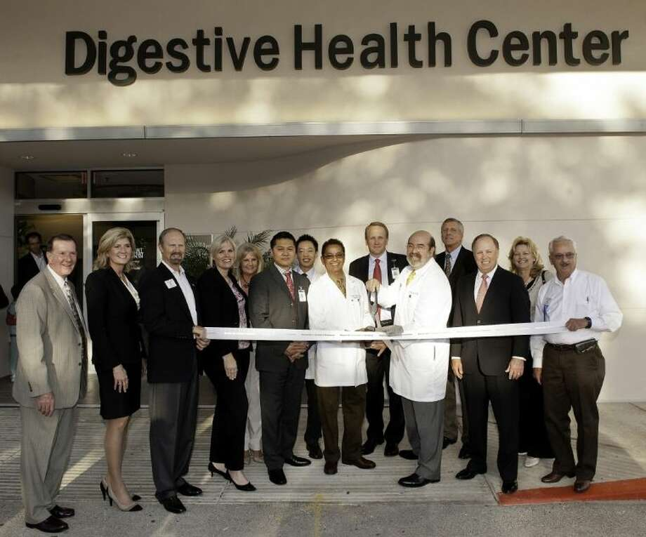 Memorial Hermann Memorial City officials and members of the Houston West Chamber of Commerce cut the ribbon at the Digestive Health Center.