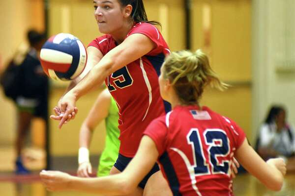 Brien McMahon's Meredith Pellegrino bumps the ball under the watchful of eye of teammate Taylor Morton during Wednesday's FCIAC volleyball game against Stamford at Kehoe-King Gymnasium in Norwalk. McMahon held on for a 25-17, 13-25, 25-16, 18-25, 15-9 win.