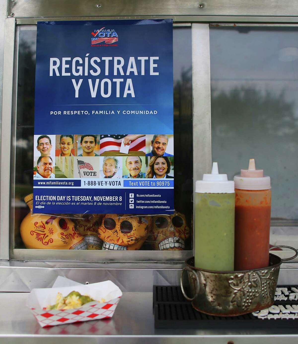 Voting registration information is displayed prominently at the Tila's Tacos truck.