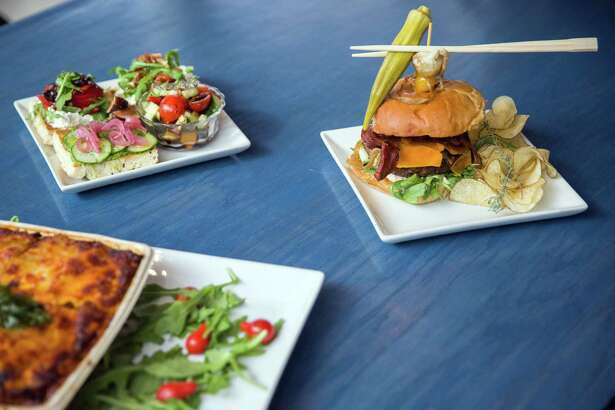 Clockwise from bottom left: Takeout lasagna, open sandwich trio and the Dijon Burger.