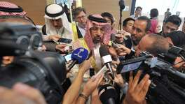 Saudi Arabia and its oil minister Khalid Al-Falih, shown at an OPEC meeting in Algeria on Tuesday, agreed to shoulder the brunt of a proposed cut in the cartel's oil production, suggesting the country's price war with U.S. shale drillers had not completely succeeded.
