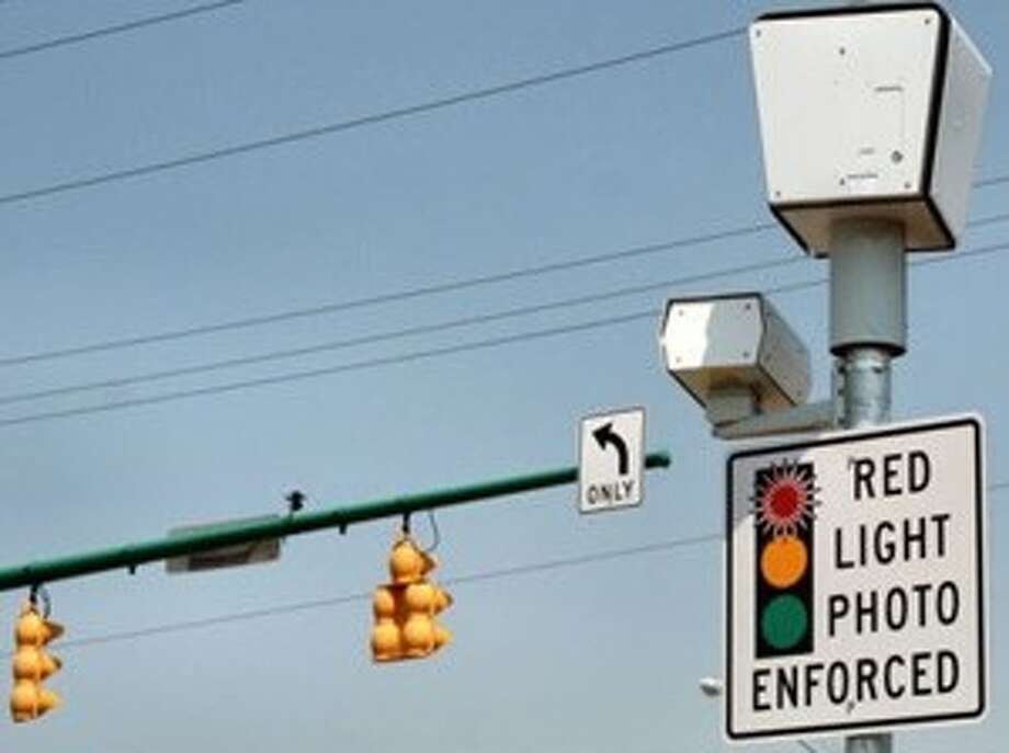 Now, the sign is accurate. Starting at 12:01 a.m. Sunday, tickets are being issued for running the 70 camera-equipped red lights in Houston. Photo: File Photo