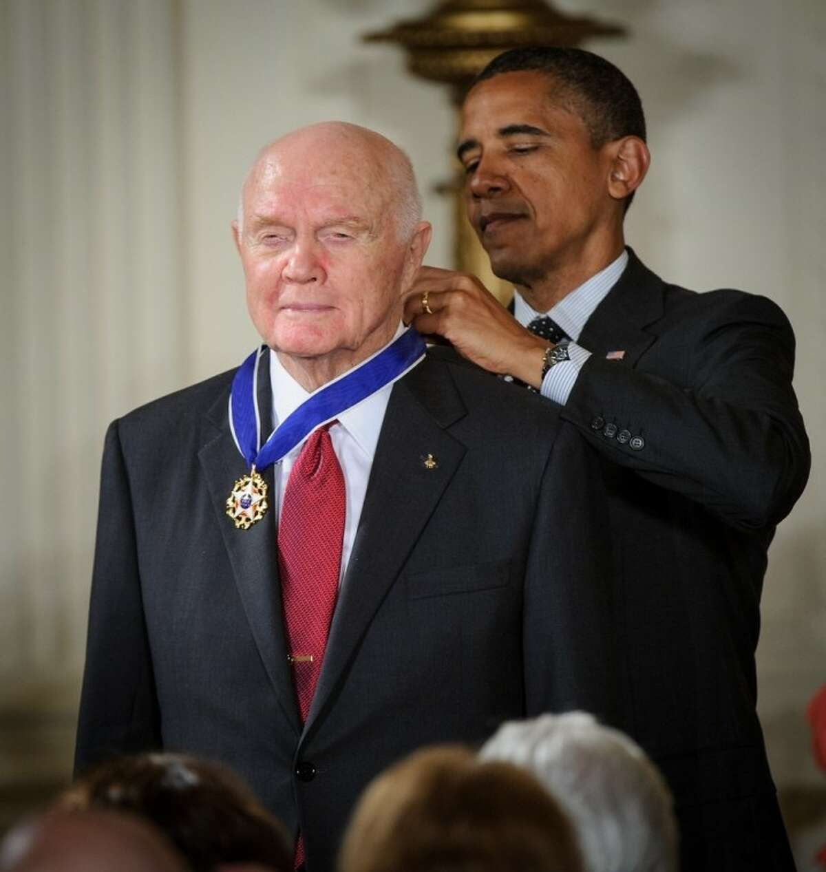 President Barack Obama presents former United States Marine Corps pilot, astronaut, and United States Senator John Glenn with a Medal of Freedom, Tuesday, May 29, during a ceremony at the White House in Washington.