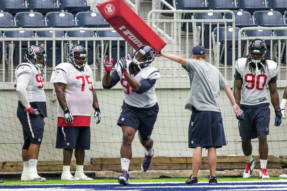 Antonio Smith, center, was back with the Texans on Wednesday in J.J. Watt's absence, but it will be players like Jadaveon Clowney (90) who will be called on to step up their production.