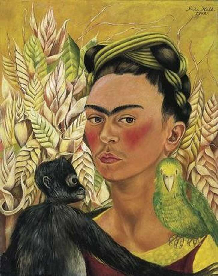 "Frida Kahlo, ""Autorretrato con chango y loro"" (Self-portrait with Monkey and Parrot), 1942, oil on masonite, Malba - Fundación Costantini, Buenos Aires. (Photo from www.mfah.org)"
