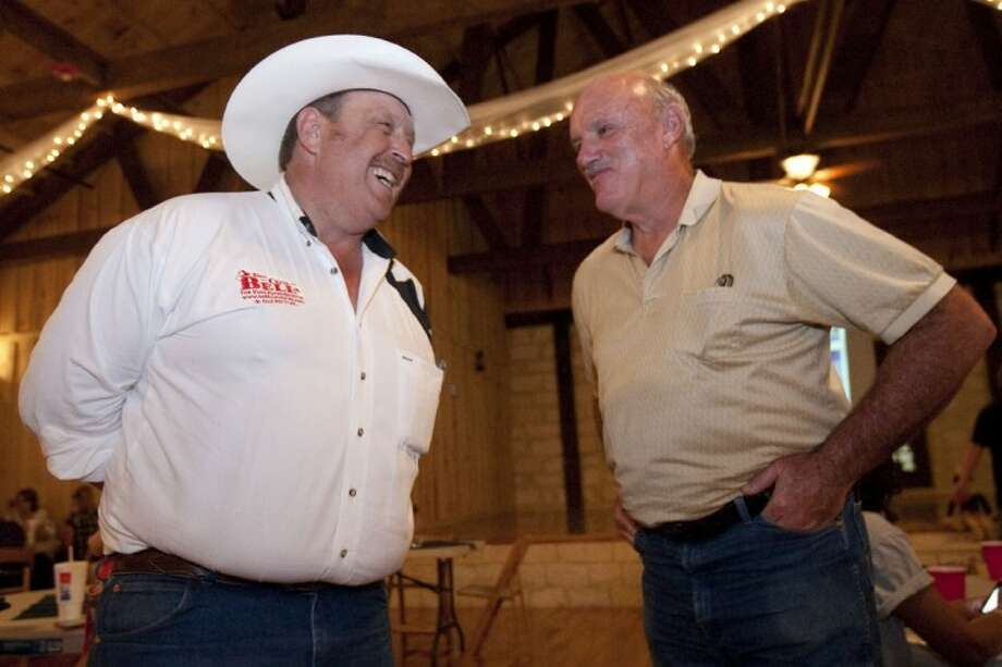 Texas House District 3 candidate Cecil Bell Jr. speaks with Ted Parmer at an election watch party at Crystal Springs in Magnolia on Tuesday. Photo: Karl Anderson