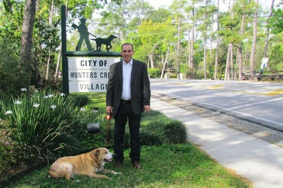 Michael Cokinos, with his dog, Rocky, along Memorial Drive in Hunters Creek. Photo: Submitted
