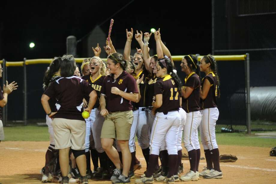 Deer Park players celebrate their victory over Pearland in the Regional Finals playoff game 2 Friday, May 25. Photo: Kirk Sides