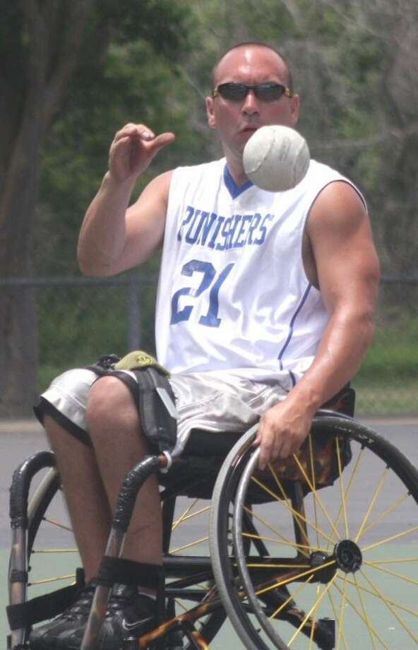 Wheelin' Outdoors shortstop Angel Gonzalez gets ready to grab a chopper during Sunday's championship game of the Wheelchair Windup Tournament at the Verne Cox Center. Gonzalez had a superb defensive game, successfully pulling off 9-of-10 fielding chances in the 6-5 victory.