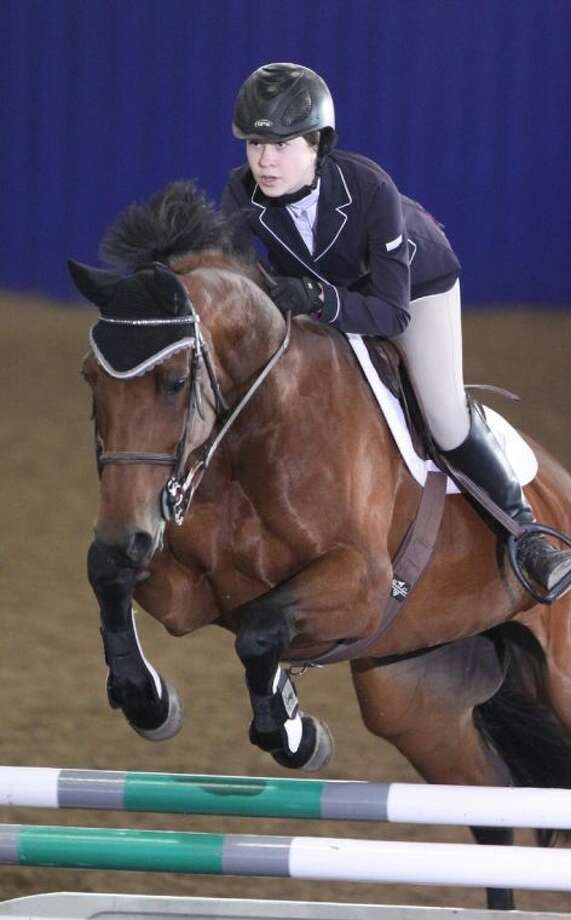 Alexandra Ozymy riding Wicarla jumps during the Pin Oak Charity Horse Show in Katy.