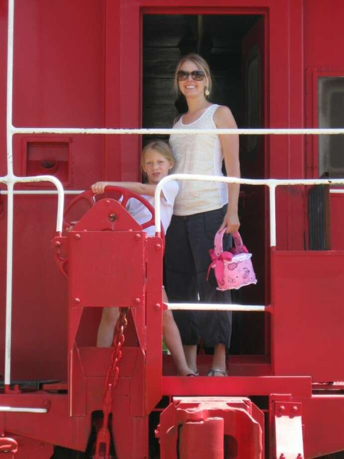 Depot Day is set for Saturday, April 20, in Magnolia. Above, kids of all ages pay a visit to the red caboose on Depot Day. Photo: Tana Ross