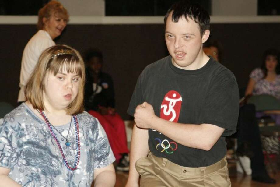 Meghan Field and Nick Gentry show off some of their square dance moves at the Star Spangled Swingers dance event at Strawbridge United Methodist Church April 2. The dance group for adults with special needs meets at the church the first and third Tuesday of every month at 7 p.m.