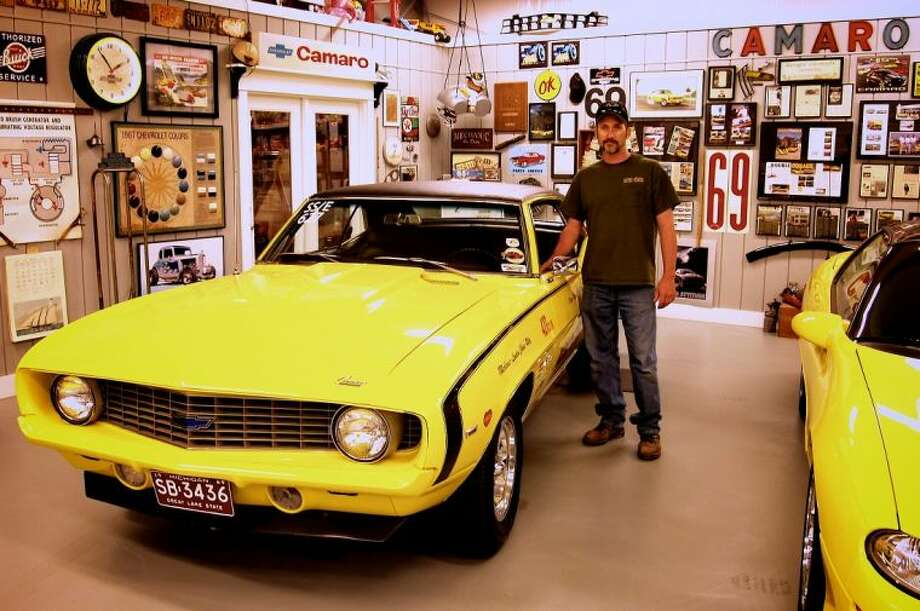 "Mike Riley shows off ""Miss B"" at the RetroPower shop in Liberty, Texas."