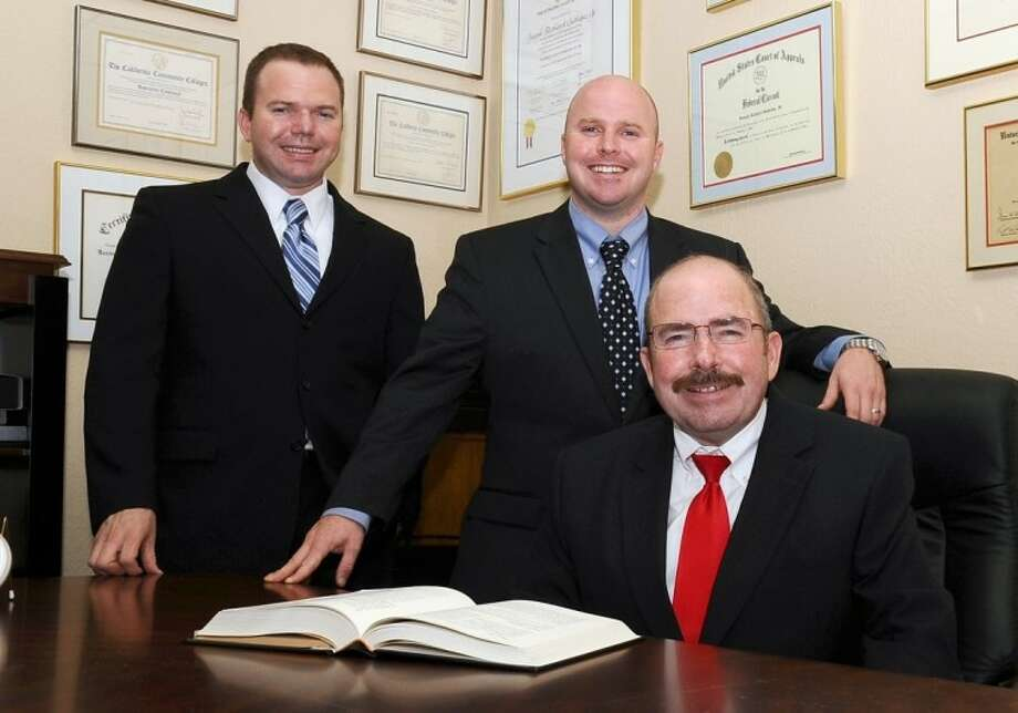 Joe Gutheinz (right) with sons Jim (center) and Mike have opened a law firm in Friendswood where all three are Partners. Photo: KIRK SIDES