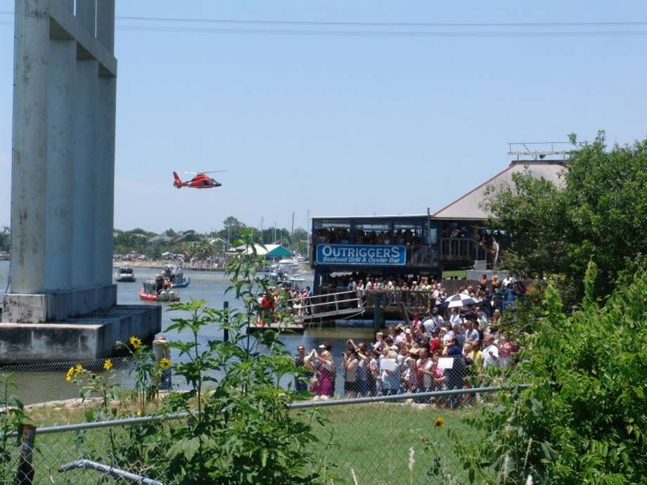 Thousands of people gathered along the shore of Clear Lake and at restaurants such as Outriggers under the Kemah Bridge to await the mock shuttle's arrival.