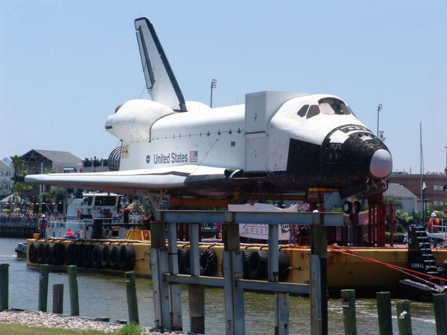 The shuttle replica passes the Kemah Boardwalk on its way to the bridge, which was shut down to allow the shuttle to pass safely.