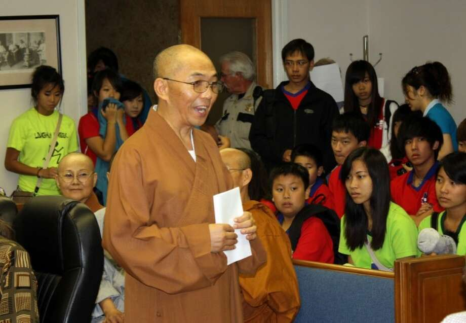 "The Rev. Hung-I Shih of the American Bodhi Center introduces the Waller County Commissioners Court to a group of about 70 students visiting from Taiwan. The students came to the center to ""see Texas, learn Texas culture ... and understand what is Texas,"" Shih said."