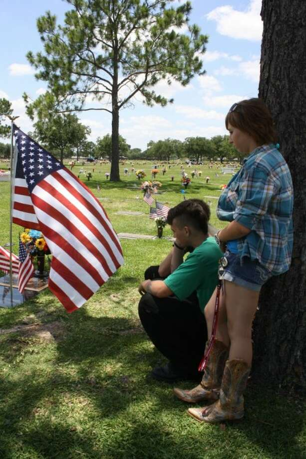 Andrew Armstrong and Cassidy Rogers paid tribute to a friend on Memorial Day. Army Pfc. Cody R. Norris of La Porte was killed last Nov. 9 in Kandahar province in Afghanistan of injuries suffered after enemy forces attacked his unit with gunfire. Photo: Y.C. OROZCO