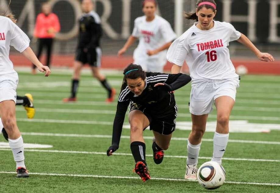 Tomball soccer player Sarah Pfrenger (16) tries to outrun the defender in the Sectional Playoff Game held at Turner Stadium. Photo: Amanda J.Cain