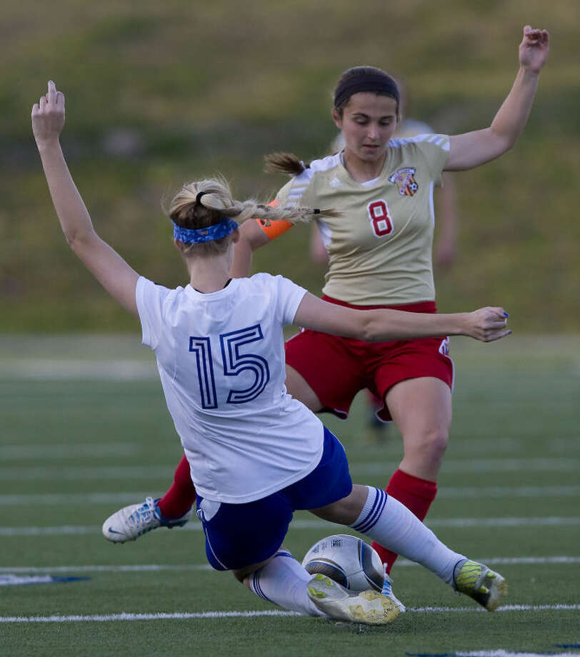 Cy-Woods Emily Bishop (8) and Kathryn Huthinson (15) of Katy Taylor battle for the ball in the Area Round of the Texas 5A UIL Girls Soccer Playoffs at Tully Stadium on Friday in Houston (Joe Buvid/Houston Community Newspapers). Photo: Joe Buvid