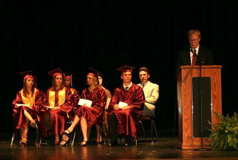 School Board Trustee Steve Crews speaks to the 2010 graduating class of ALPHA Academy on May 25.