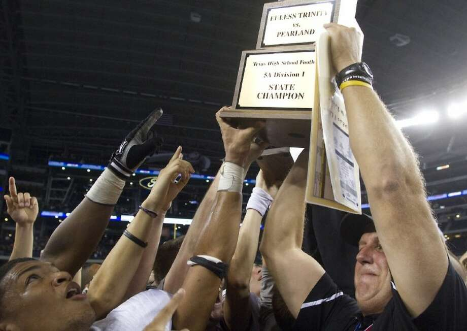 Pearland coach Tony Heath and his Oilers defeated Euless Trinity 28-24 to capture last year's Class 5A Division I state championship at Cowboys Stadium in Arlington. Photo: PATRIC SCHNEIDER