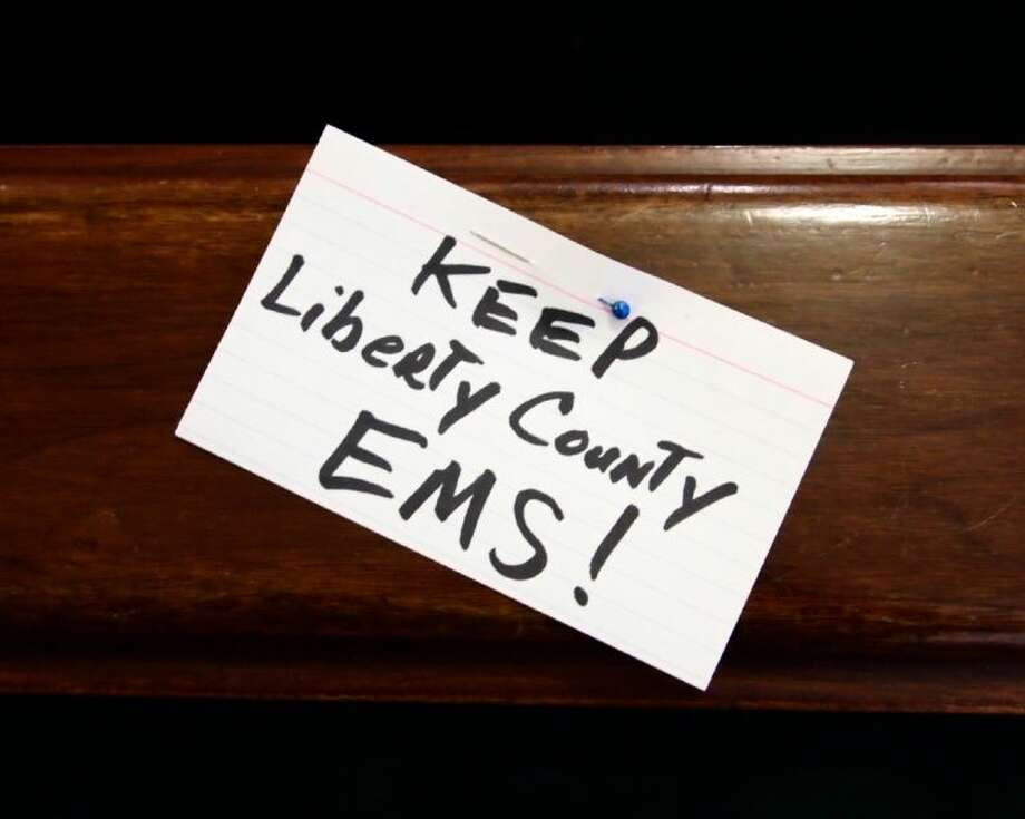 Index cards were handed out by supporters of Liberty County EMS at the March 26 commissioners court meeting. Photo: CASEY STINNETT