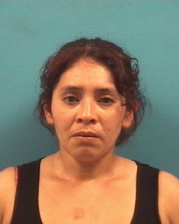 Marcela Villagomez, 34, was taken into custody as s fugitive from justice and arrested for failure to Identify and driving with a suspended license Saturday, June 2. She also faces first-degree felony charges of possession of a controlled substance in a drug-free zone after jailers allegedly discovered cocaine in her purse. Photo: Pearland Police Dept.