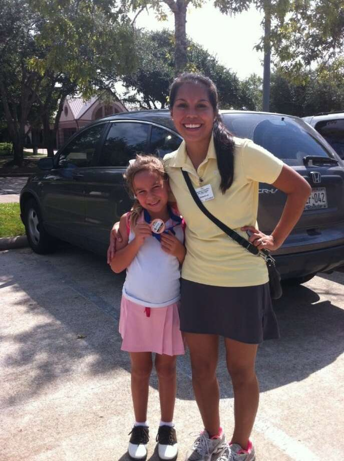 Savannah Wright of Deer Park placed fourth in the co-ed 7-9 age group at Bay Oaks' junior golf tournament. Her caddy, Stefanie Avilez Lau, was Deer Park golf district champ in 2006. Wright is 7 years old and in 2nd grade at Carpenter Elementary.