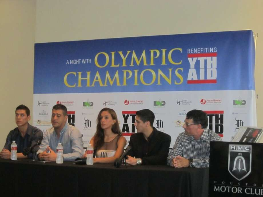 "Taekwondo Olympians Jean (coach), Diana, Steven and Mark Lopez, all Kempner High graduates, and Youth Aid founder Pete Sanchez speak during ""A Night With Champions"" press conference."