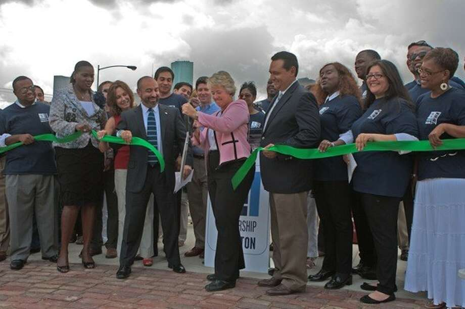 Mayor Annise Parker cuts the ribbon to dedicate Memorial Silver Triangle Plaza, along with members of Leadership Houston Class XXX, whose project it was.