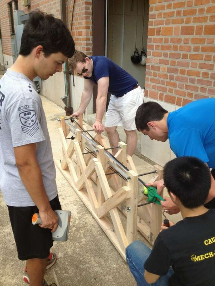 Rice University students prepare to test elements of their Acceleration-Deceleration Equipment Tester, developed at the request of the Air Force. From left: John Stretton, Duncan Eddy, Tremayne Kaseman and William Li. Photo: RICE UNIVERSITY