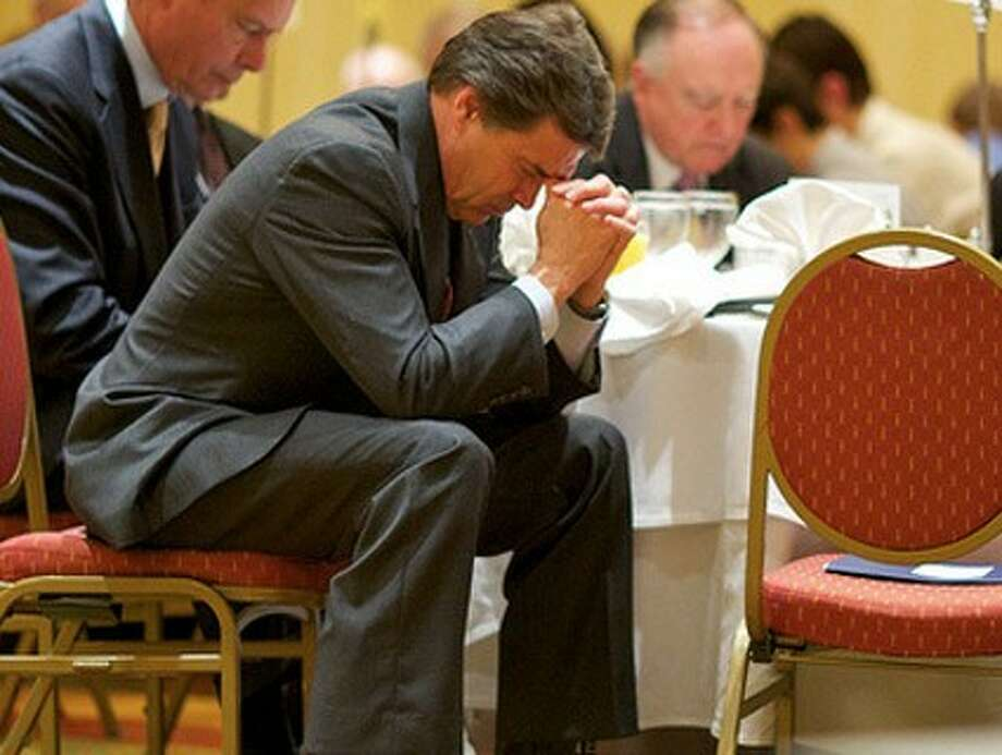 Perry at prayer.