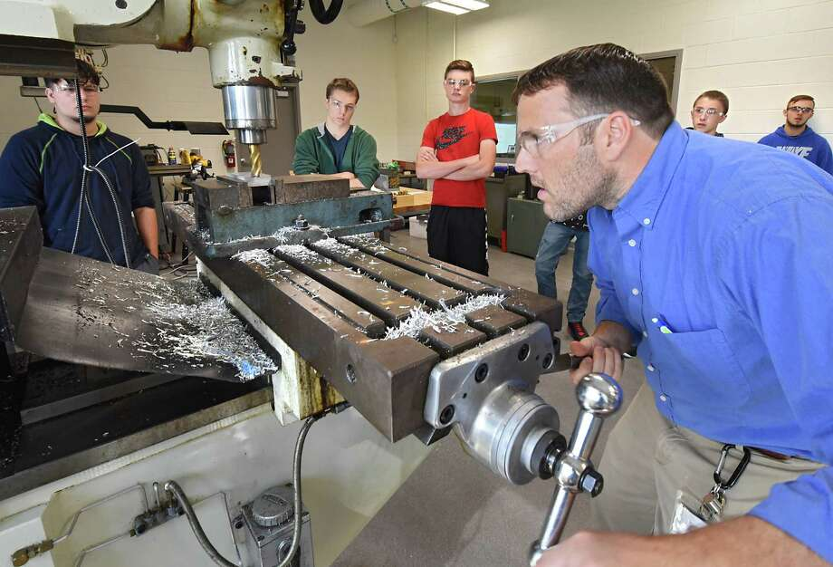 Teacher John Winters, right, instructs students on how to use a milling machine during his manufacturing 1 class at the Center for Advanced Technology at Mohonasen High School on Tuesday, Sept. 27, 2016 in Schenectady, N.Y. The $48.2 million capital project comes equipped with lab spaces for students interested in careers in technology (electrical, machining, manufacturing, nanotechnology), media, science and health professions. Depending on the field, students will have the option to earn college credit or to work toward a professional certificate. Evening courses will also be available for adults in the region.(Lori Van Buren / Times Union) Photo: Lori Van Buren / 40038169A