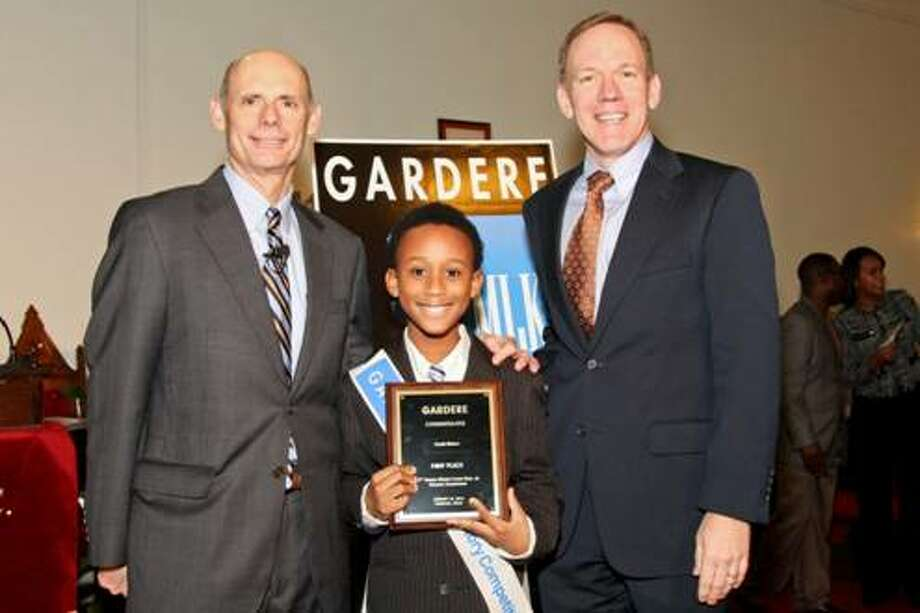 From L to R: Event chair, emcee and Gardere Operating Partner Claude Treece, first place winner of the 17th Annual Gardere MLK Jr. Oratory Competition and fourth-grade student at Lockhart Elementary Curtis Babers and Gardere Trial Partner and long-time event supporter Stephen Moll. (Photo by Kim Coffman)