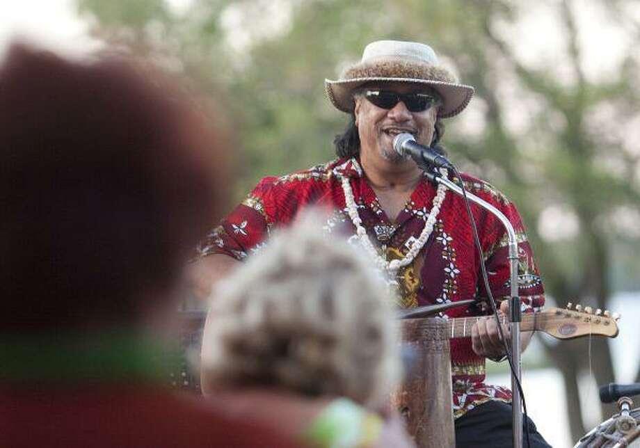 Chief Tama Satoafaiga of Drums of the Pacific performs a traditional Hawaiian song during a Luau performance. / Gabriel Chmielewski