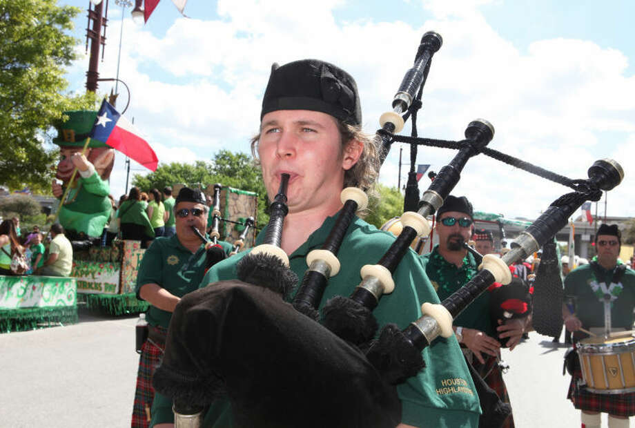 Chris Creevan of the Houston Highlanders plays the bagpipes during the Houston St. Patrick's Day Parade in downtown Houston on Saturday, March 16. Photo: Photo By Alan Warren