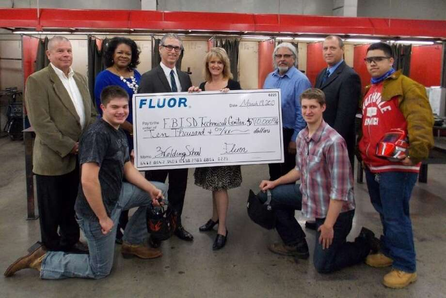 Pictured (front, from left) are students: Matthew Moody, Denton Markwalter and Elias Herrera; and (back row, from left) Bernie Rackley, Manager of Talent Development at Fluor; Barbara Jones, Senior Manager of Community and Public Affairs at Fluor; Andy Ralph, Executive Director of Sales at Fluor and President-Elect of the Fort Bend Education Foundation; Brenna Smelley, Executive Director, Fort Bend Education Foundation; Billy Canales, welding teacher; and Kenny Kendziora, Technical Education Center Supervisor.