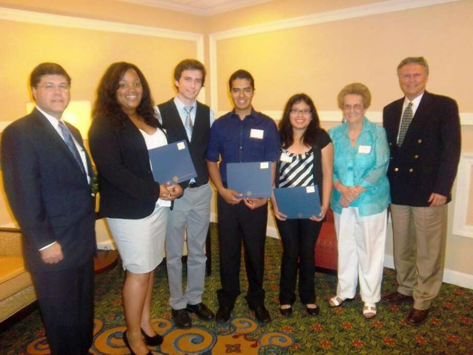 Teen Volunteers Brianna Ledet, Daniel Schultz, Osvaldo Hernandez and Gabriele Coronado Lopez received scholarships from Memorial Hermann Northeast Hospital. Presenting the awards are hospital CEO Louis Smith, far left; Donnie Redmon, second from right, second vice president-Student Volunteers; and Norman Funderburk, Northeast Hospital Foundation president.